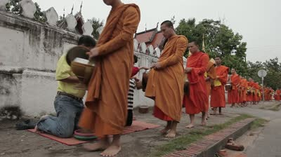 stock-footage-luang-probang-laos-october-bhuddhist-monks-receiving-daily-food-donations-outside-wat