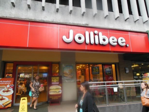 Typowe wejście do Jollibee - czerwono-białe